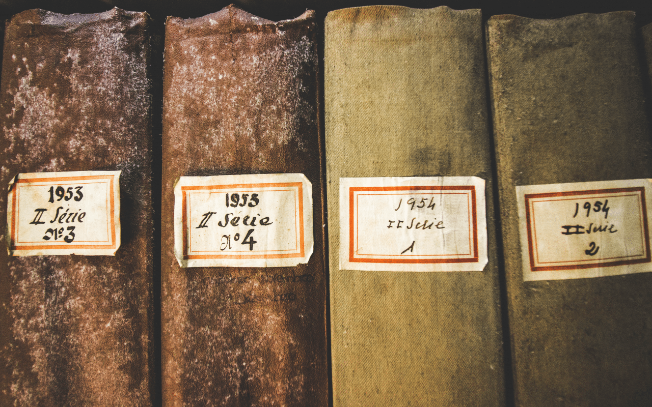 four old books with mold on them
