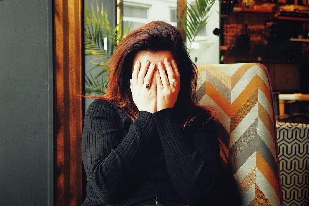 Woman covers her own face